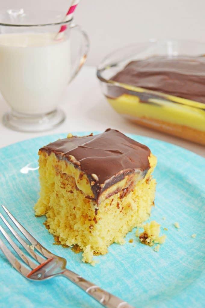 Easy Boston Cream Poke Cake Recipe - Tuxedo Cats and Coffee